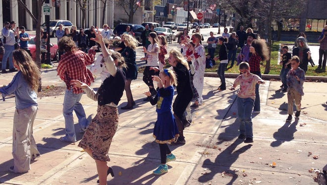 """Flash mobbers dance to Michael Jackson's """"Thriller"""" in downtown Fond du Lac in October 2014. The Fond du Lac Public Library, in concert with Julie Wilson of Shut Up & Dance, will celebrate the Fond du Lac Reads selection of """"Dracula"""" with another flash mob."""