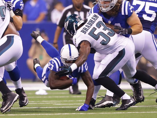 Indianapolis Colts running back Frank Gore (23) dives