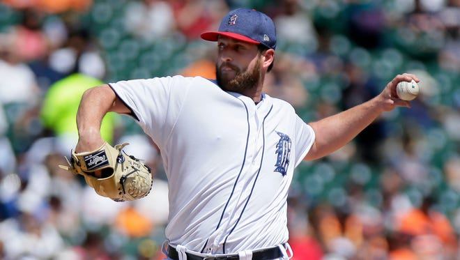 Tigers pitcher Chad Bell throws during the fourth inning of the Tigers' 11-8 loss Sunday at Comerica Park.