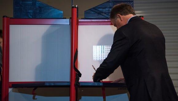 U.S. Senate candidate Doug Jones votes in Mountain