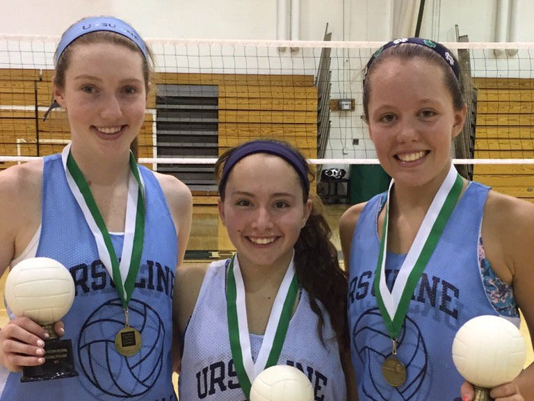 lohud volleyball player of the week Katie McLoughlin (left) was named to the all-tournament team at Yorktown with teammates Milena Ciaccia (center) and Maura McGlynn (right). Sept. 17, 2016.