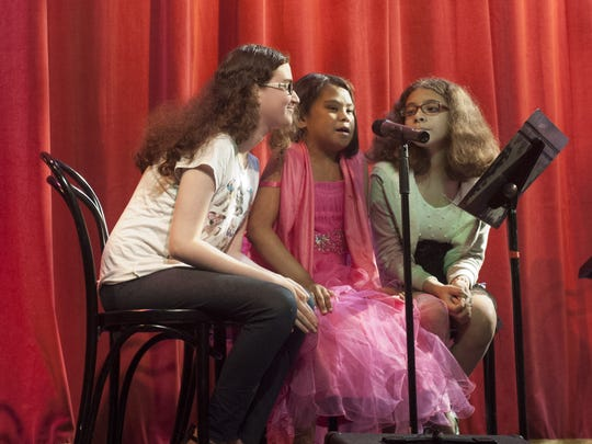 15-year-old Samaritan Hospice patient  Aracelis Mercado (center) sings with her sisters, Samara Qunonez (left) and Mayra Mercado at the Ritz Theatre Company in  Haddon Township. Celi is receiving hospice care from Samaritan Healthcare & Hospice for end-stage renal disease.
