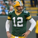Green Bay Packers quarterback Aaron Rodgers (12) reacts after an incomplete pass in the fourth quarter during the game against the Detroit Lions at Lambeau Field.