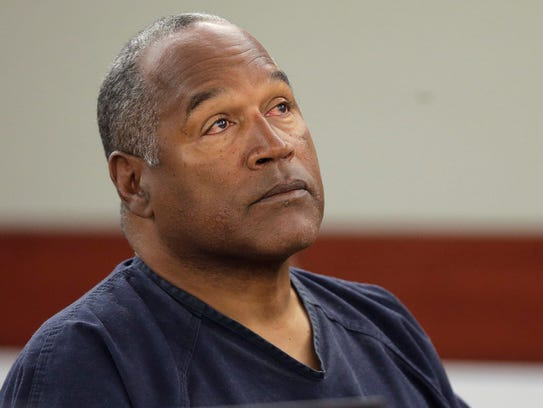O.J. Simpson listens to testimony at a hearing in Clark