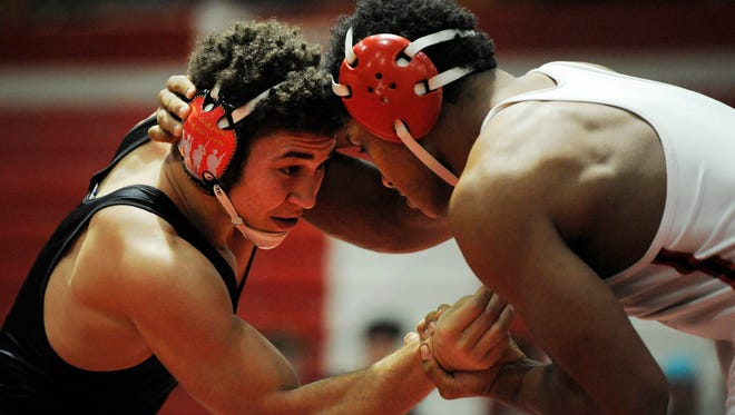 In the 170 class New Albany's Aaron Mosley (right) defeated Jeffersonville's Kameron Fuller during the IHSAA Wrestling Sectionals on Saturday at Jeffersonville High School. (Photo by David Lee Hartlage, Special to The Courier-Journal) Jan. 28, 2017