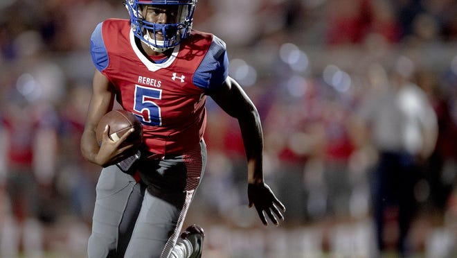 Hays quarterback Durand Hill, in action last year versus Bowie, had a late touchdown run for the Rebels to seal a 42-35 win over Austin High Friday at Bob Shelton Stadium.