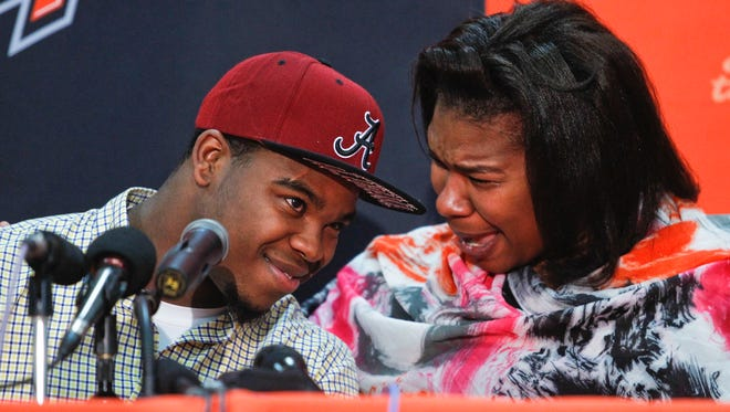An emotional Esther Harris is overcome with joy as her son, Madison Southern's Damien Harris, finds that Alabama fits him as he announces his college of choice Friday afternoon in Berea, Ky. The highly-touted running back chose the Tide over Kentucky and Ohio State. Jan. 9, 2015