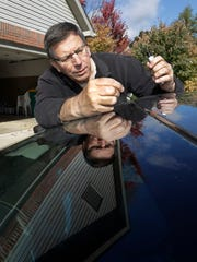 Associated Press Auto Writer Tom Krisher touches up