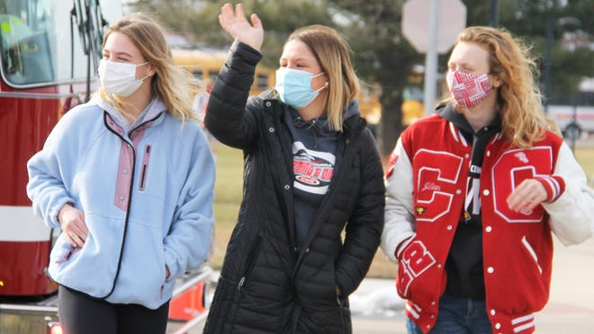 Charlotte Calhoun, Mia Rzepka and Jillian McKinley, Coldwater High School athletes headed to state swim and dive finals this weekend, were cheered on with a spirit parade by classmates, staff, friends and parents Thursday after school.