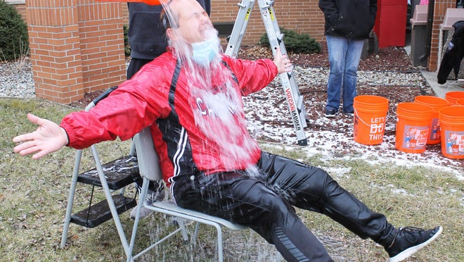Coldwater High School Principal Bill Milnes endured the cold water challenge Friday morning for the sake of the Humane Society of Branch County fundraiser, hosted by the CHS Young Republicans Club.