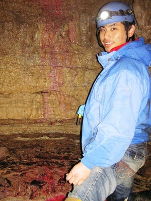 TSU graduate student Hung Wai Ho conducts a tracer study with Rhodamine dye in Mammoth Cave to determine water flow route.