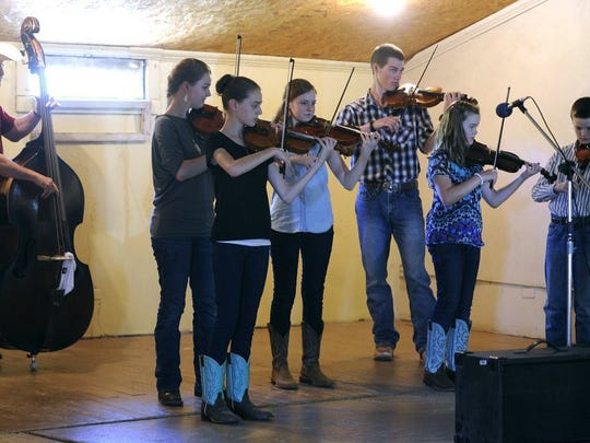 Thomas Metthe/Reporter-News The Earthmans, six brothers and sisters, all filled players perform together during the Old Timer's Fiddlers Contest at the Texas Cowboy Reunion on Saturday, July 2, 2016, in Stamford.