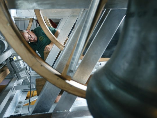 Bellhanger Neil Thomas, with the Whitechapel Bell Foundry in London, takes care of the final touches during the installation of the bells at the Church of the Ascension in Rochester.