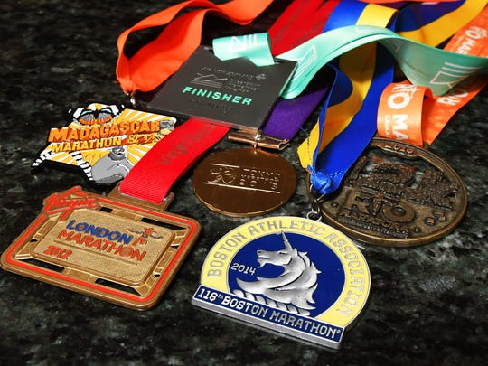 Medals from marathons on six continents. Cindy Bishop