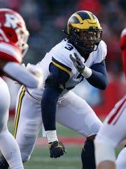 Michigan's Rashan Gary defends against Rutgers last November.