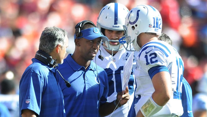 Colts offensive coordinator Pep Hamilton talking to QB Andrew Luck, tight end Coby Fleener and coach Chuck Pagano during his first season. He wouldn't last three in Indy.