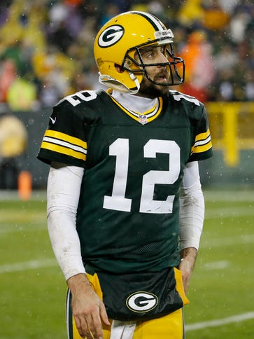 Green Bay Packers' Aaron Rodgers walks off the field