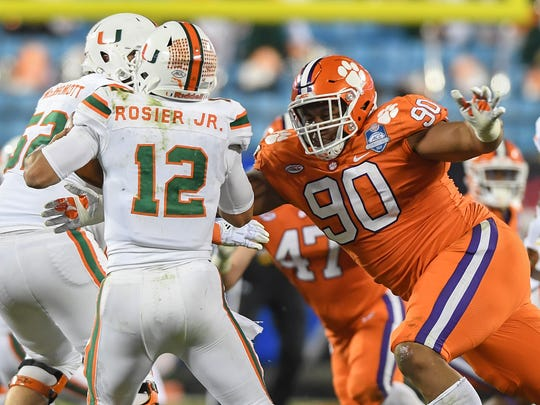 Clemson defensive lineman Dexter Lawrence (90) brings down Miami quarterback Malik Rosier (12) during the 3rd quarter of the ACC championship game against Miami at Bank of America Stadium in Charlotte on Saturday, December 2, 2017.