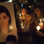 A candlelight vigil was held in the Evesham Township's Memorial Sports Complex in memory of singer Christina Grimmie. The Evesham native was gunned down last month in Orlando.
