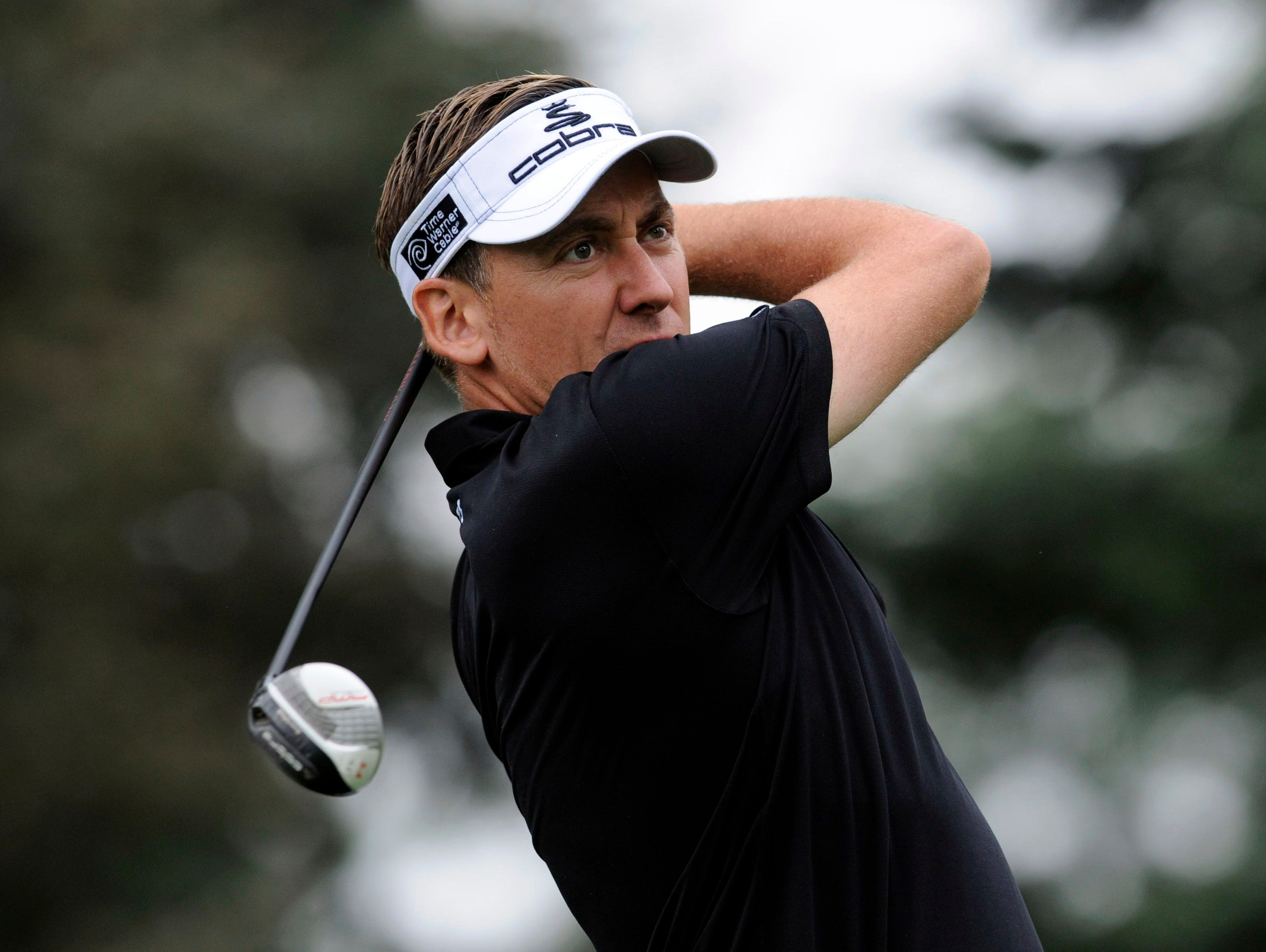 Ian Poulter tees off on the 7th hole during the second round.