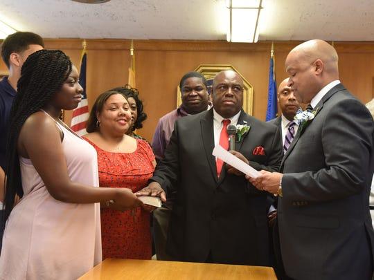 Councilman David Sims  sworn in at the  reorganization