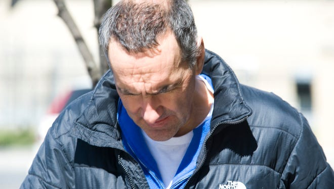 Louis James Soteriou, 54, of Middlebury, Conn., leaves federal court in Burlington, Vt., on March 27, 2012 after being charged with 18 counts of mail fraud, money-laundering and wire fraud for an alleged scheme to attract $28 million in investments for a film project.