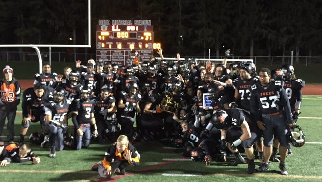The Marlboro High School football team poses with the Section 9 Class B championsip plaque
