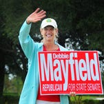 Debbie Mayfield, candidate for state senate, has been campaigning all day from Indian River County to Brevard County, holding signs and greeting voters. At 5:00 p.m. Mayfield was at the Church at Viera waving to voters. #321vote