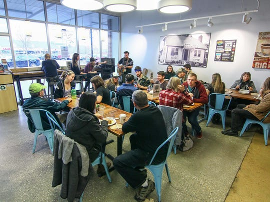 Customers dine and listening to live music while eating their lunch during the inaugural Funky Funday Vegan Brunch Sunday, Jan. 21, 2018, at Newark Natural Foods in Newark, DE