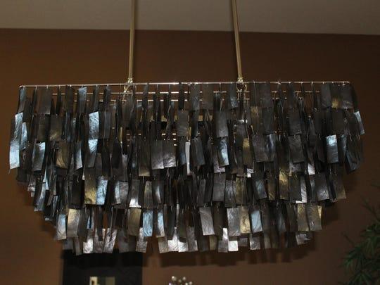 A unique dining room light fixture is best appreciated