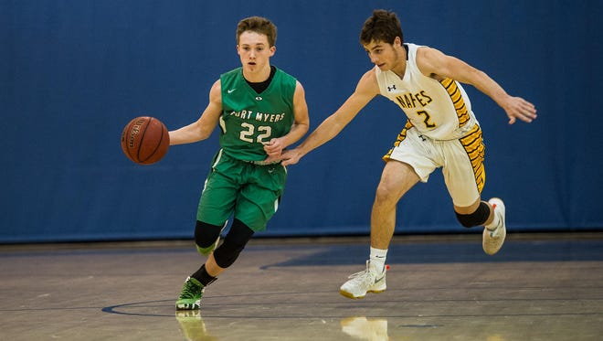 Fort Myers High School's Brady Luttrell brings the ball up court during a game against Naples High School on Thursday.