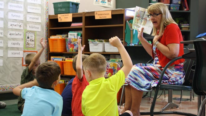 """Terry Maxwell reads """"First Day Jitters"""" to her first-grade class at Ralph Williams Elementary, on the first day of school in Brevard County. The Brevard school board recently voted unanimously to adopt a $902 million budget for 2016-17, up from last year's $849 million but short of the $973 million budget in 2014-15."""
