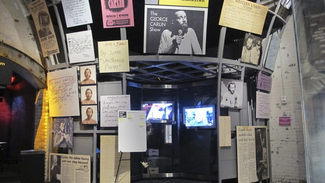 The George Carlin exhibit is seen inside the National Comedy Center in Jamestown, N.Y. Visitors to the center can explore the late comedian's archives of notes and other material, which the center acquired from Carlin's family.