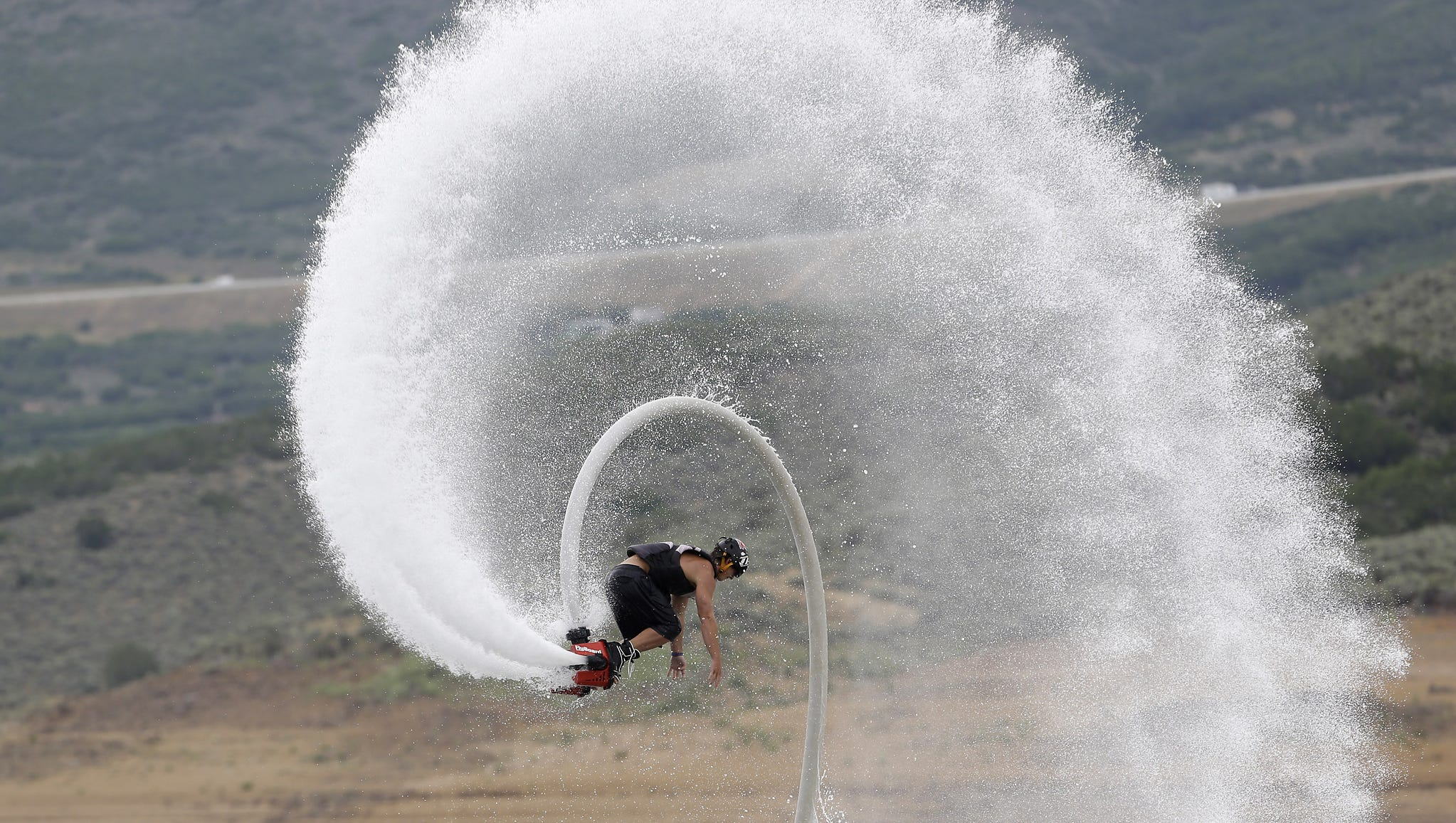 Rocky Mountain Flyboard instructor Chase Shaw does a flip with his flyboard at the Jordanelle Reservoir on July 24 at Jordanelle State Park, Utah. The device, which looks like a small snowboard attached to a hose, can propel a rider 45 feet in the air using water pumped from a personal watercraft like a jet ski.