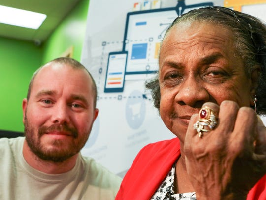 John Gurley, left, sits near Doris Baskin, right, both of Anderson, moments after he met her for the first time in Anderson. Gurley, who looks for silver and gold treasures with his metal detector, found her lost 1964 Westside High School class ring. Baskin said she lost the ring 52 years ago on the grounds of the former Anderson Country Club.