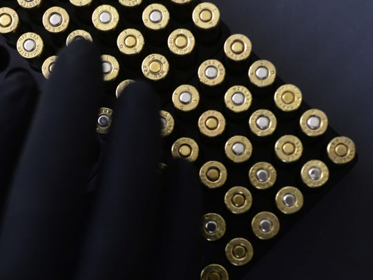 Rounds of reloaded .223 bullets being sorted at DavTac Custom Arms & Ammo's new shop.
