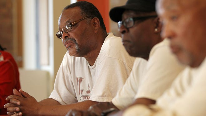Dwight Williams, 58, of College Hill, left, listens to DeAnna Hoskins, Hamilton CountyÕs Re-entry Director, during a mentoring session for people who have served time in prison and are having difficulty finding a good-paying job, Thursday, May 7, 2015, at the First Unitarian Church.