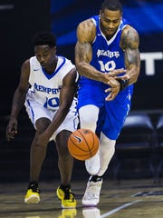 June 25, 2016: Jimmie 'Snap' Hunter ( left) and Will Coleman (right) hustle for possession of the ball during the first quarter of the second annual Memphis basketball alumni game at Elma Roane Fieldhouse Saturday. The Blue vs. Gray game was hosted by former players Willie Kemp and Jeremy Hunt. (Yalonda M. James/The Commercial Appeal)