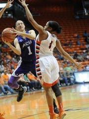 Joey D. Richards/Reporter-News Abilene Christian's Sara Williamson (1) drives while Texas-El Paso's Lulu McKinney defends. UTEP beat the Wildcats 66-62 in the first-round WNIT game on Thursday, March 17, 2016 at the Don Haskins Center in El Paso.