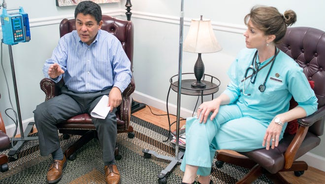 Rheumatologist Jose Pando discusses treatments corresponding to Medicare alongside his wife, Katherine Welton-Pando, a registered nurse who administers infusions to patients with rheumatoid arthritis.