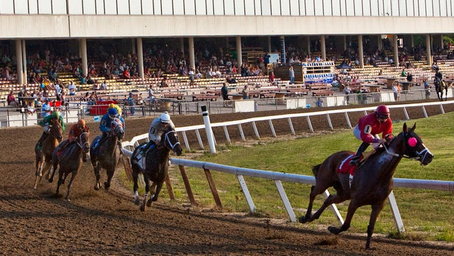 In this July 2, 2010 photo, spectators watch a horse race at the old Lincoln Race Course.