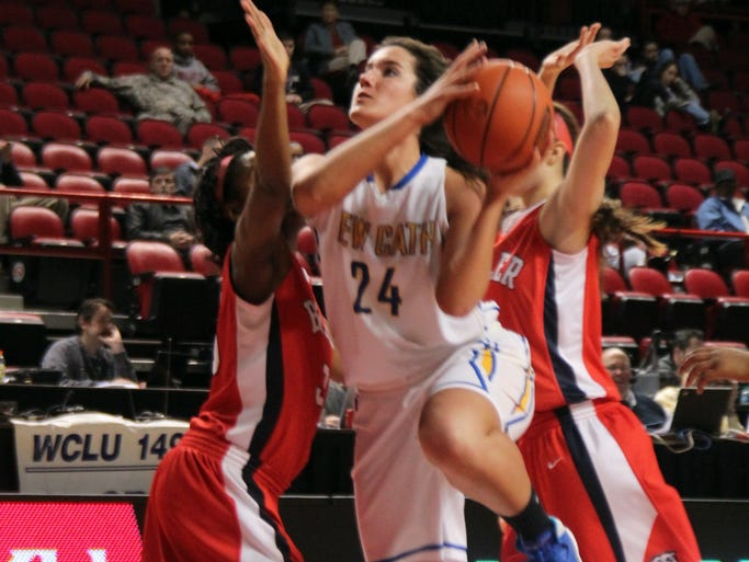 NewCath senior Nikki Kiernan splits two Butler defenders.