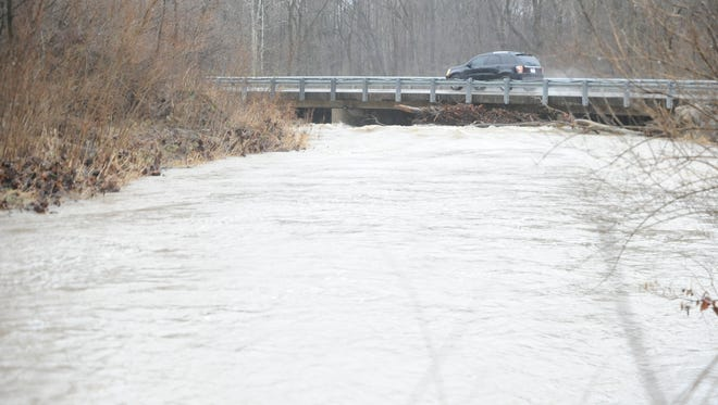 The level of the Whitewater River was elevated Monday and the river was moving quickly, but it was no threat to motorists on Waterfall Road.
