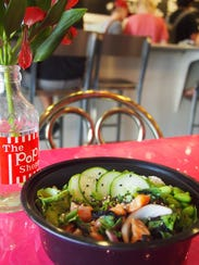 Ponzu kale poke bowl with salmon, red onion, ginger,