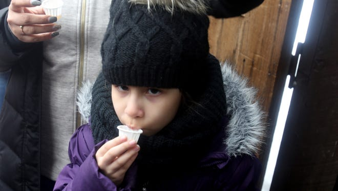 Mya Guzman, 7, of Queens, tastes freshly made maple syrup in the sugar shack at the Fresh Air Fund's Sharpe Reservation in Fishkill during the 14th annual Maple Celebration March 18, 2017. Along with making maple syrup, the annual Fresh Air fund fundraising event included wildlife exhibits, crafts, a planetarium, food, and more.