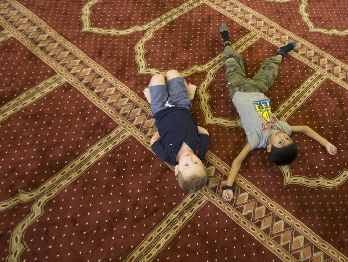 Rafferty Love, 2 (L) and Ayub Ally, 6, play inside