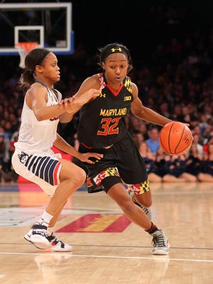 Maryland Terrapins guard Shatori Walker-Kimbrough (32) drives against Connecticut Huskies guard Moriah Jefferson (4) during the third quarter at Madison Square Garden. Connecticut defeated Maryland 83-73.
