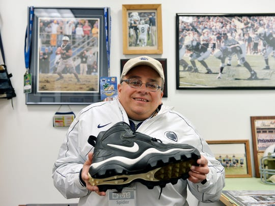 "Brad ""Spider"" Caldwell shows a size-18 shoe -- the"