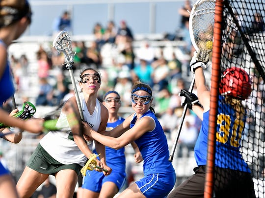 York Catholic's Amanda Tufano shoots the ball against Kennard-Dale goalkeeper Clare Boone, who made the save, in the first half of the YAIAA girls lacrosse championship game Thursday, May 12, 2016, at Central York. Kennard-Dale defeated York Catholic 16-11 for the title.