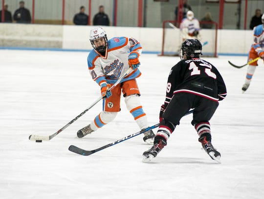Detroit's Stone Rolston (10) lines up to pass the puck